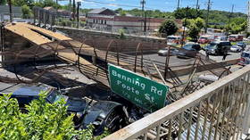 Pedestrian bridge collapses in DC, leaving 4 hospitalized and shutting down highway (VIDEO)