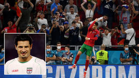 Ronaldo pelted with Coca-Cola bottle before pitch invader reaches him... and goals legend Ali Daei hails 'caring humanist' (VIDEO)