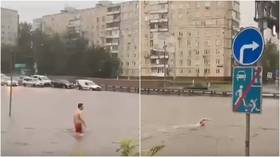 VIDEOS show defiant Russians SWIMMING in Moscow's flooded streets as 'super rain' turns roads into canals