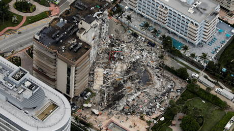 An aerial view showing a partially collapsed building in Surfside near Miami Beach, Florida, US