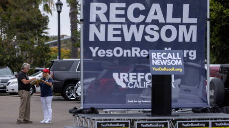 Supporters of the recall campaign of California Governor Gavin Newsom prepare for the upcoming recall election with a rally in Carlsbad, California, June 30, 2021.
