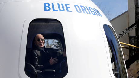 FILE PHOTO: Amazon and Blue Origin founder Jeff Bezos addresses the media about the New Shepard rocket booster