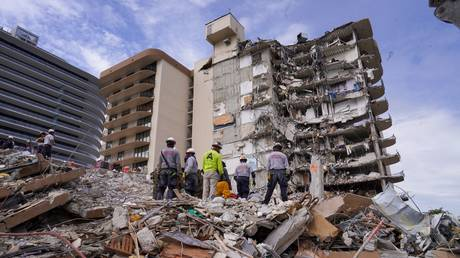 Search and rescue workers are shown on Friday at the site of the condominium collapse in Surfside, Florida.