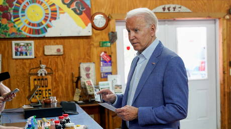 Joe Biden buys pies and jam at King Orchards farm store in Central Lake, Michigan