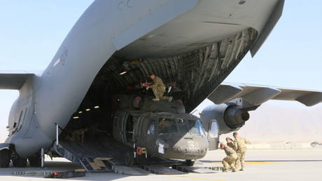 A UH-60L Blackhawk helicopter is loaded into a US Air Force C-17 Globemaster III during the withdrawal of American forces in Afghanistan, June 16, 2021.