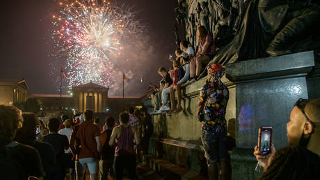 Spectators watch the annual Independence Day fireworks display outside the Philadelphia Museum of Art in Philadelphia on July 4, 2021