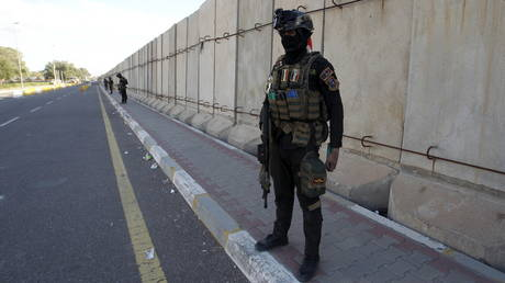 FILE PHOTO: Iraqi security forces stand guard near the gates of Baghdad's heavily fortified Green Zone.