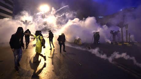 Lebanese people protest against coronavirus (Covid-19) lockdown in Tripoli, Lebanon on January 27, 2021. © Houssam Shbaro/Anadolu Agency via Getty Images
