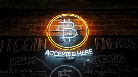 A neon logo of virtual cryptocurrency Bitcoin is seen at the Bitcoin Embassy bar.