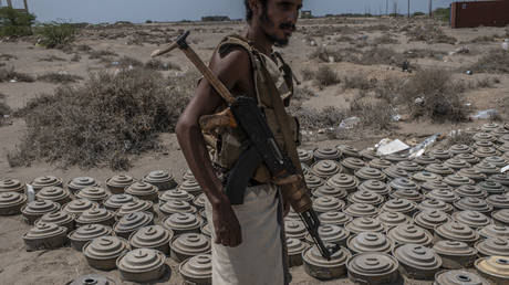A fighter with the Tariq Salah Forces, a militia aligned with Yemen's Saudi-led coalition-backed government, shows Houthi rebel landmines the militia had recovered, at an outpost a few kilometers from the frontline on September 22, 2018 in Al-Himah, Yemen.