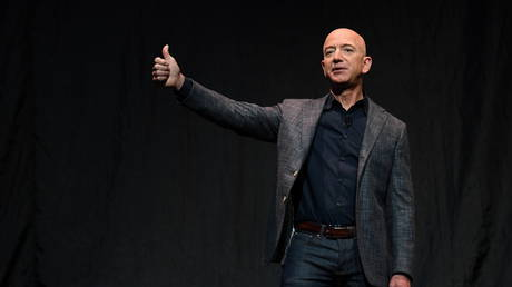 FILE PHOTO: Jeff Bezos gives a thumbs up as he speaks during an event about Blue Origin's space exploration plans in Washington, US,