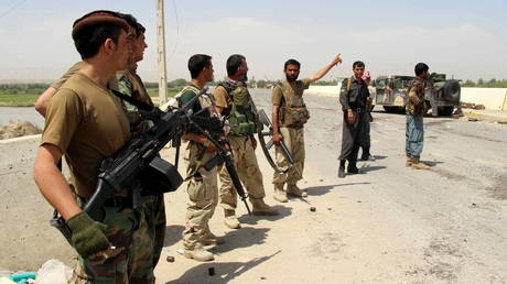 FILE PHOTO. Afghan National Army troops keep watch at a checkpoint at Chardara district, in Kunduz province, Afghanistan