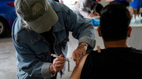 Nurse gives patient his coronavirus disease (COVID-19) vaccine at rural vaccination site in Columbus, New Mexico