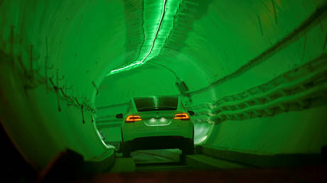 FILE PHOTO: A modified Tesla Model X drives in a tunnel entrance before an unveiling event for the Boring Co. Hawthorne test tunnel in Hawthorne, California.