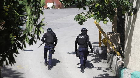 Police officers walk near the private residence of Haiti's President Jovenel Moise after he was shot dead by gunmen in Port-au-Prince, Haiti, July 7, 2021