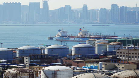 Oil tanks at the China National Petroleum Corporation (CNPC)'s Dalian Petrochemical Corp in Dalian, Liaoning province, China