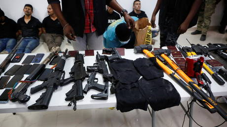Weaponry, mobile phones, passports and other items are being shown to the media along with suspects in the assassination of President Jovenel Moise, Port-au-Prince, Haiti July 8, 2021