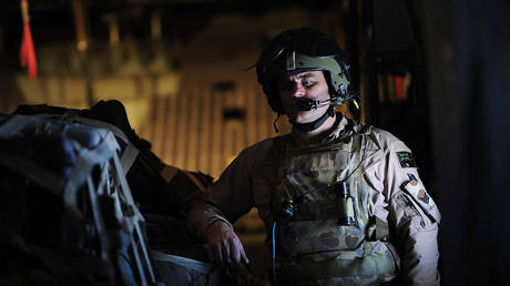 An Australian soldier on board a C-130 military airplane prepares for landing during a flight from Kabul to Kandahar on July 31, 2010.