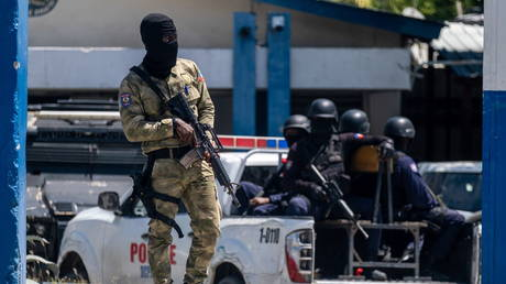 Armed Haitian troops guard the entrance of the General Directorate of the police where the suspects of the assassination of Haiti's President Jovenel Moise are detained, in Port-au-Prince, Haiti, July 10, 2021