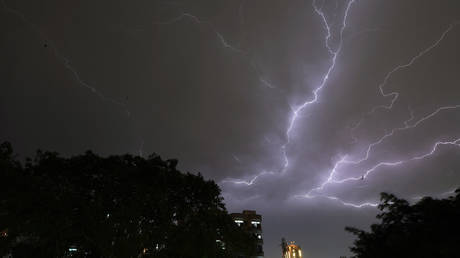 Lightning strikes over residential apartments during a thunderstorm on the outskirts of the Indian capital New Delhi on May 2, 2018.
