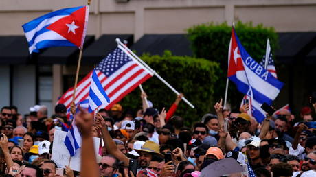 Cuban exiles in Miami, Florida wave American flags, July 11, 2021.