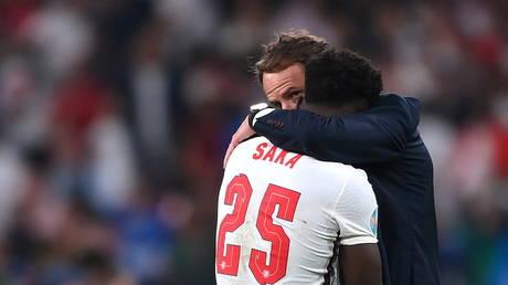 England manager Gareth Southgate consoled Bukayo Saka after his penalty miss. © Reuters