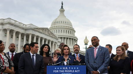 FILE PHOTO: House Speaker Nancy Pelosi outside the US Capitol with Texas Democrats during their previous visit to Washington, June 15, 2021.