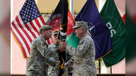 """General Austin """"Scott"""" Miller, commander of U.S. forces and NATO's Resolute Support Mission, hands over his command to U.S. Marine General Kenneth McKenzie, during a ceremony in Kabul, Afghanistan July 12, 2021. © Reuters/High Council for National Reconciliation Press Office"""