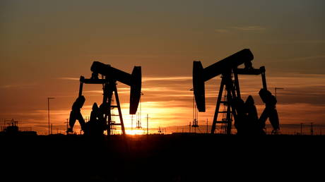 FILE PHOTO: Pump jacks operate at sunset in an oil field in Midland, Texas US