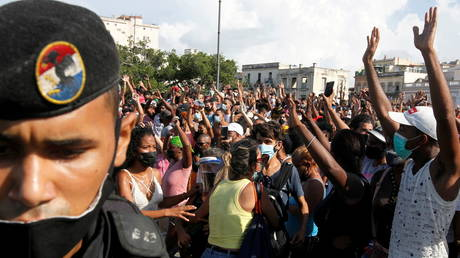 People react during protests against and in support of the Cuban government, in Havana, Cuba, July 11, 2021.