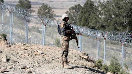 A soldier stands guard along the border fence at the Angoor Adda outpost on the border with Afghanistan in South Waziristan, Pakistan October 18, 2017.