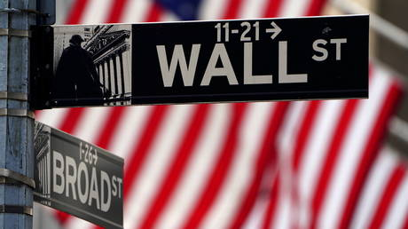 FILE PHOTO: A Wall Street sign is pictured outside the New York Stock Exchange in New York, US