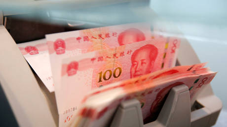 FILE PHOTO: Chinese 100 yuan banknotes in a counting machine.