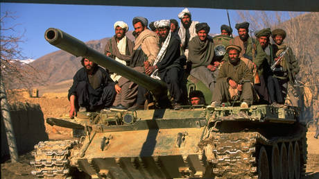 Taliban fighters w. tank at HQ taken fr. opposition Hekmatyar mujahedin by radical Islamic cleric-led faction on top in civil war, nr. govt-held Kabul. © Robert Nickelsberg/Getty Images