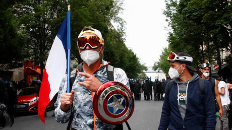 Protests against mandatory vaccines and health passes announced by French President Emmanuel Macron in Paris, July 14, 2021.
