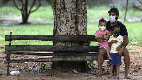 File photo: Brazilians outside a Covid-19 vaccination center in in Manaus, May 3, 2021.