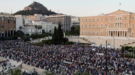 Protesters take part in a demonstration outside the parliament building after the government announced mandatory vaccinations for certain sectors, in Athens, Greece, July 14, 2021.