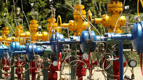 FILE PHOTO: Wellheads at an oil rig.