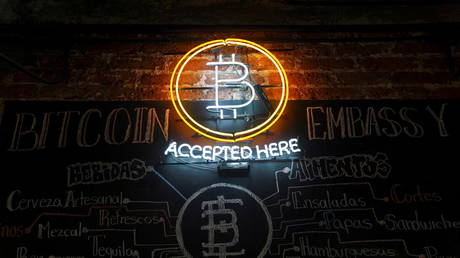 A neon logo of virtual cryptocurrency Bitcoin is seen at the Bitcoin Embassy bar in this illustration taken June 1, 2021.
