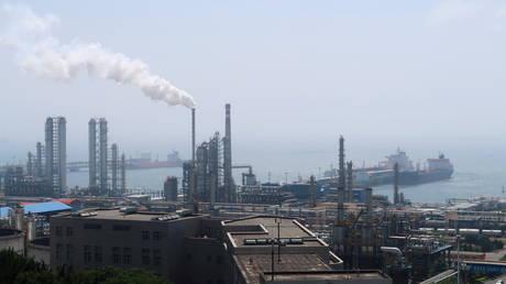 FILE PHOTO: China National Petroleum Corporation (CNPC)'s Dalian Petrochemical Corp refinery is seen near the downtown of Dalian, China