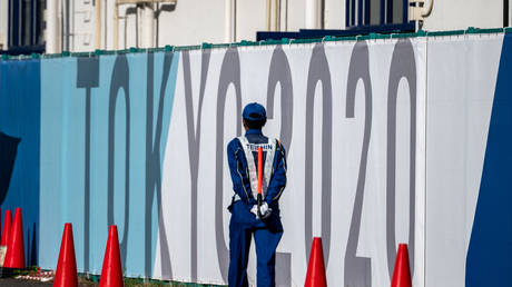 A security guard at the Olympic and Paralympic Village in Tokyo, Japan, July 15, 2021. © Philip Fong/AFP