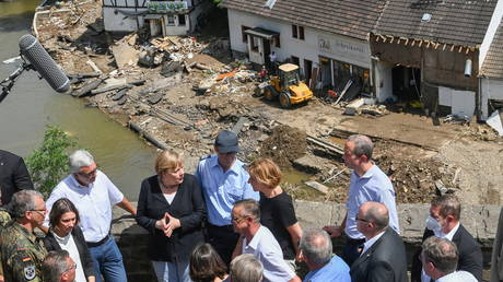German Chancellor Angela Merkel visits the flood-ravaged areas in the Rhineland-Palatinate state, Germany, on July 18, 2021.