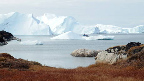 FILE PHOTO: Fishing vessels are seen next to the icebergs near Ilulissat, Greenland