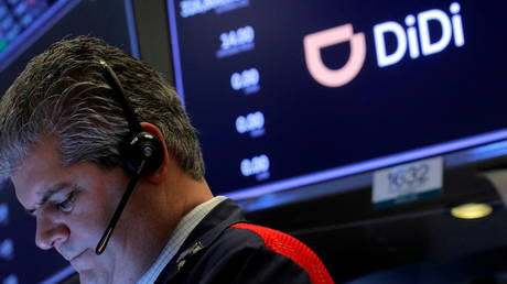 FILE PHOTO: A trader works during the IPO for Chinese ride-hailing company Didi Global Inc on the New York Stock Exchange.