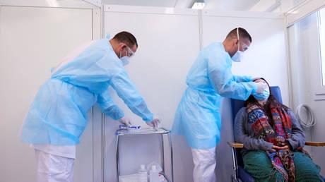 Healthcare workers at La Tour Hospital in Meyrin near Geneva, Switzerland, November 26, 2020.