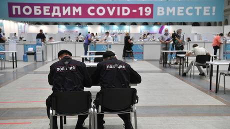"""Law enforcement officers register to receive a dose of Russia's Gam-COVID-VAK (trademark """"Sputnik V"""") coronavirus vaccine at the vaccination point in Gostiny Dvor, in Moscow, Russia. © Sputnik"""
