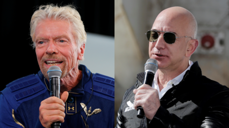 Richard Branson (L) and Jeff Bezos (R) © Reuters / Joe Skipper and Isaiah J. Downing