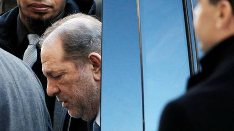 FILE PHOTO: Harvey Weinstein is shown arriving at a court in New York City in February 2020, when jurors were deliberating on sexual-assault charges against him.