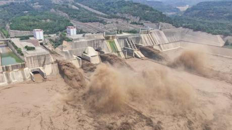 FILE PHOTO: An aerial photo shows water being released from the Xiaolangdi Reservoir Dam in Luoyang in China's central Henan province on July 5, 2021 © AFP