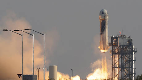 Blue Origin's first manned space flight is shown launching on Tuesday near Van Horn, Texas.